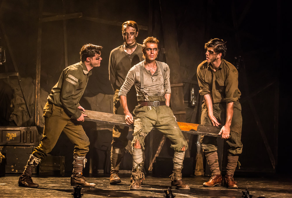 "The Trench  – Les Enfants Terribles Theatre Company This darkly beautiful myth of the First World War echoes the look of a Topolski drawing: scarred and blackened and jagged and cramped, with the odd gleam of lanterns… the overall vision stays with you like a strange, significant dream…Burt, the protagonist, played by Ben Warwick, has a soul filled with anguish"" ✮✮✮✮ THE TIMES"