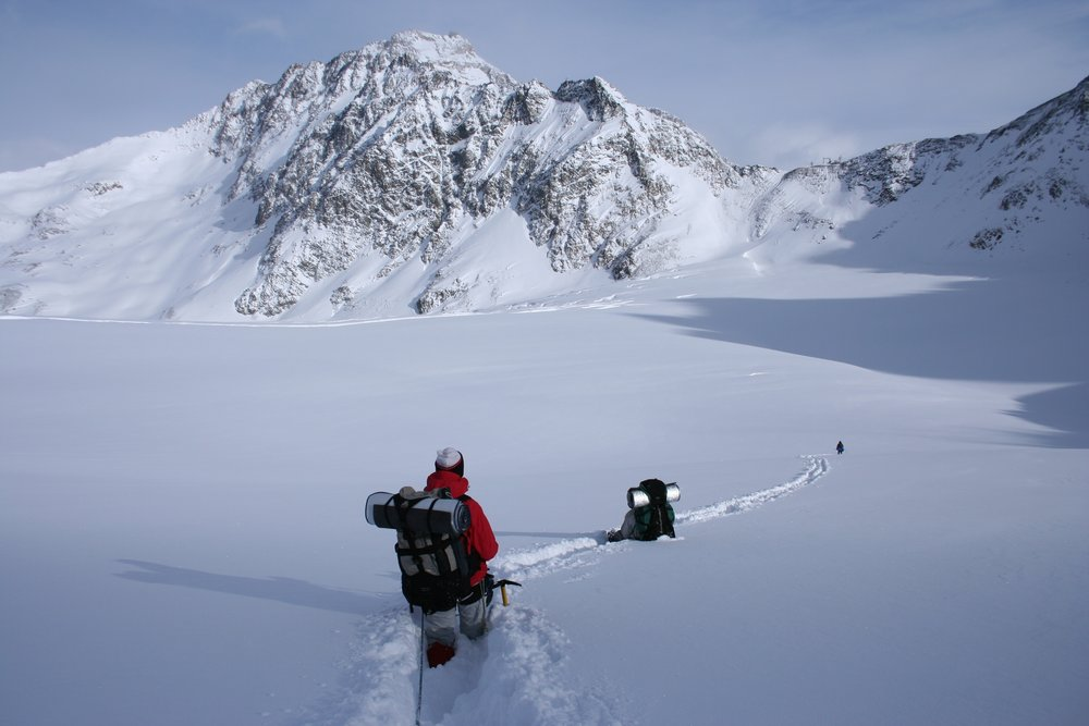 Guy walking through the snow about to climb a mountain. The weekend warrior.