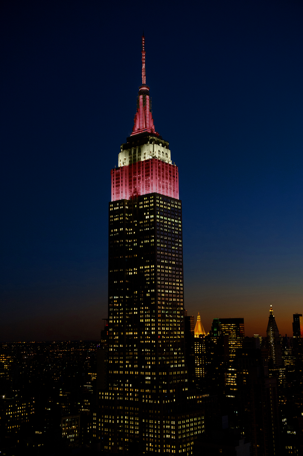 NYC's iconic Empire State Building illuminated in the colors of Latvia's flag.