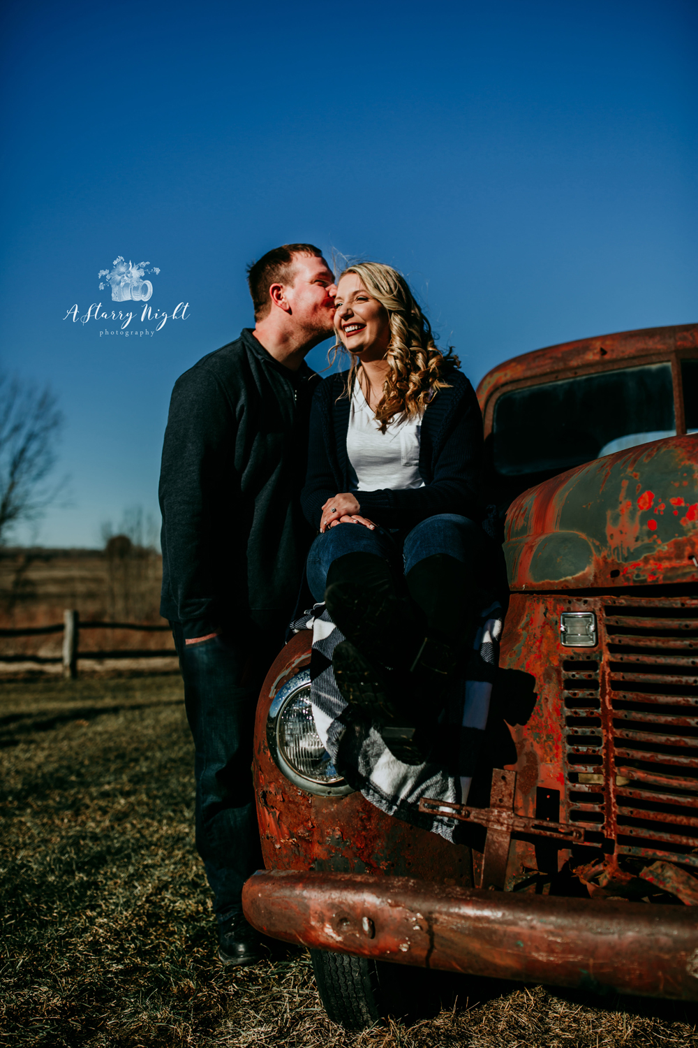 A fun and romantic Dark and Moody Engagement shoot over at Crooked River Barn in Beaverton, MI.