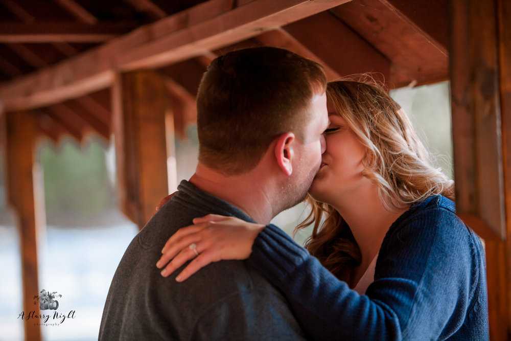 Couple kissing during their spring engagement session