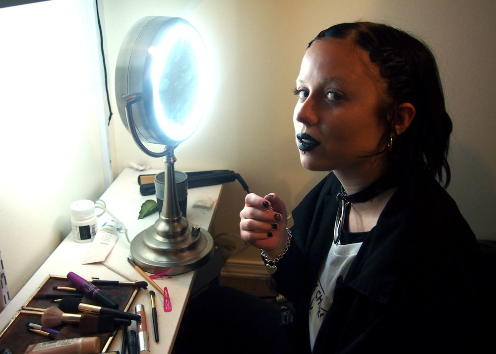 Jay at their makeup station in their apartment.