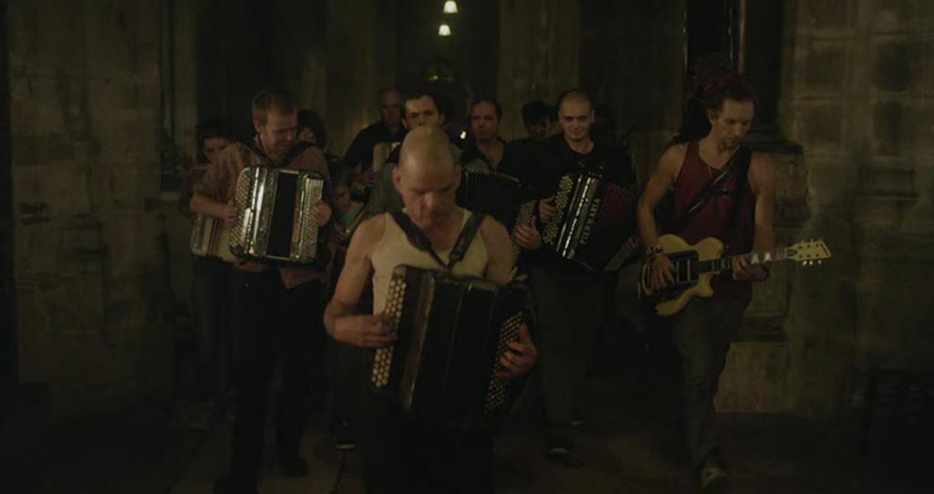 M. Oscar's (Denis Lavant) entr'acte musical number.