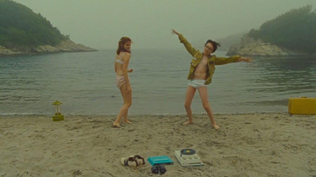 Sam and Suzy dance on the beach.
