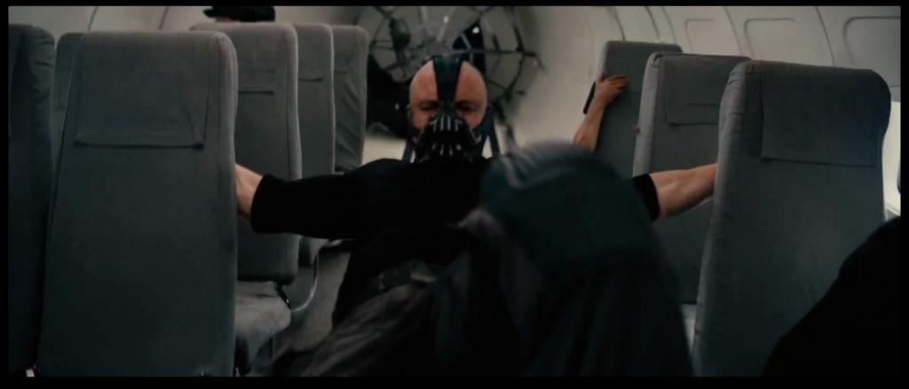 Bane (Tom Hardy) hijacks a plane.
