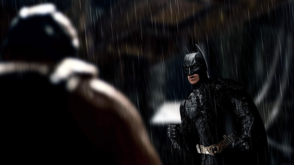 Batman (Christian Bale) faces off against Bane (Tom Hardy).