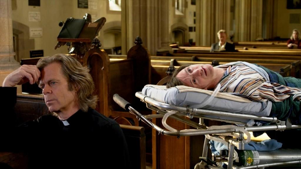 Mark O'Brien (John Hawkes) seeks spiritual counsel from his priest, Father Brendan (William H. Macy).