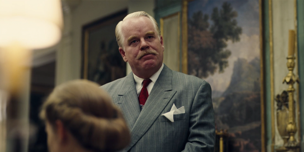 Lancaster Dodd (Phillip Seymour Hoffman) offers his Cause to a weary American populace.