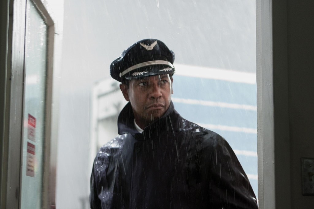 Captain Whip Whitaker (Denzel Washington) gets ready to board his plane.