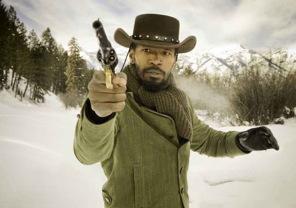 Django (Jamie Foxx) practices his quick draw.