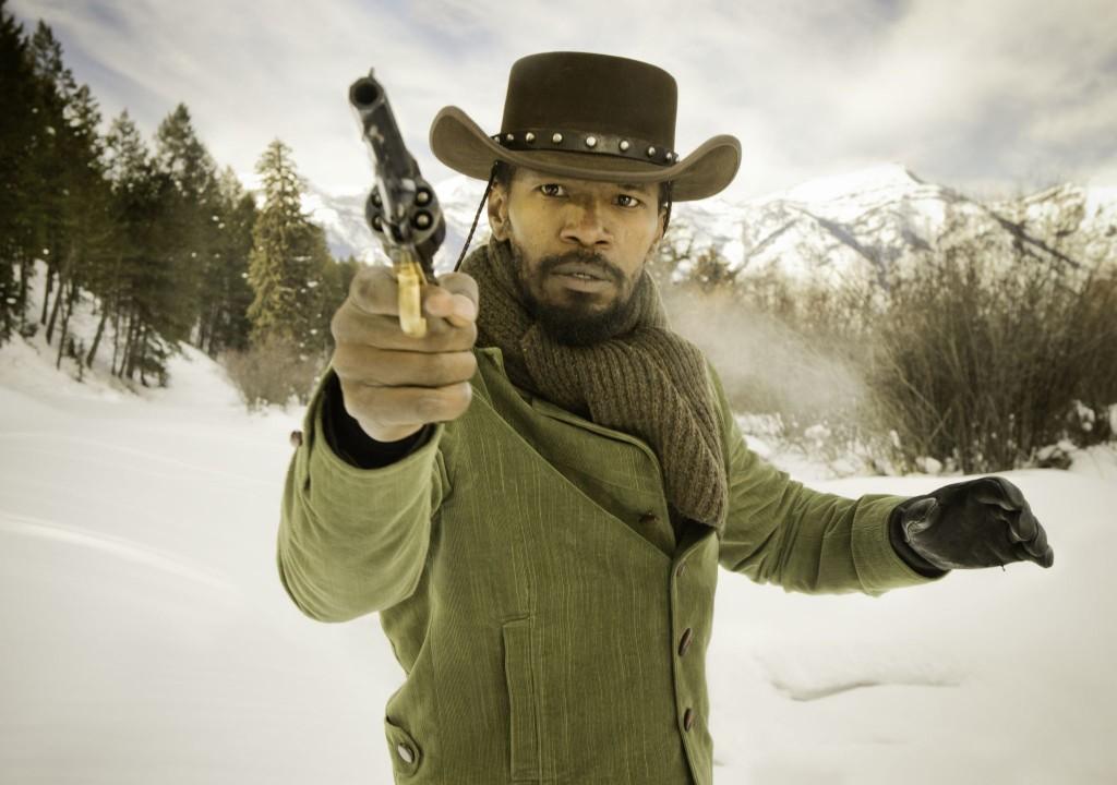 Django (Jamie Foxx) practices his quick draw.