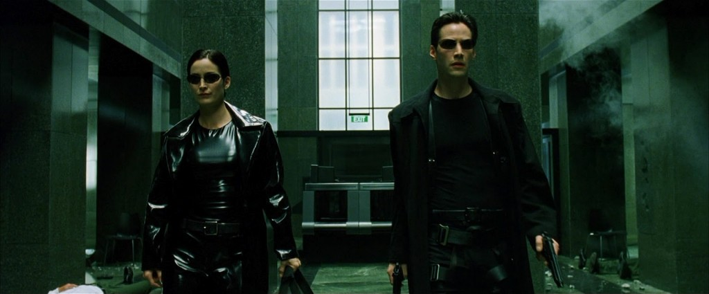 Neo (Keanu Reeves) and Trinity (Carrie Anne Moss) in the Lobby.