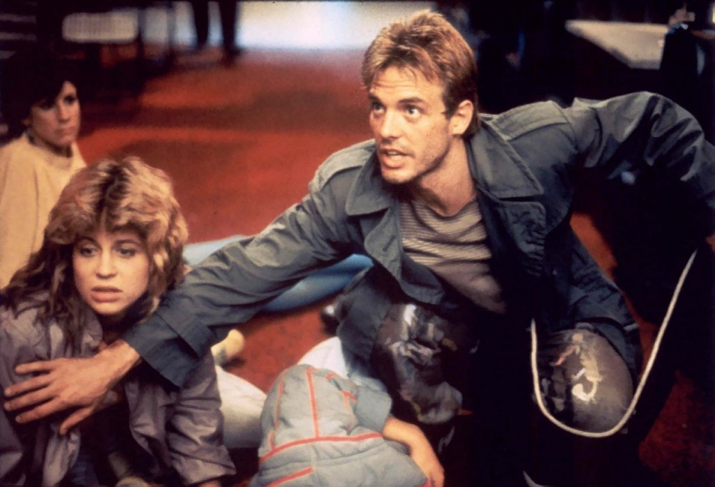 Kyle Reese (Michael Biehn) protects Sarah Connor (Linda Hamilton) from the Terminator.