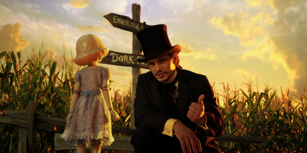 Oz (James Franco) tries to comfort the China doll girl (Joey King).