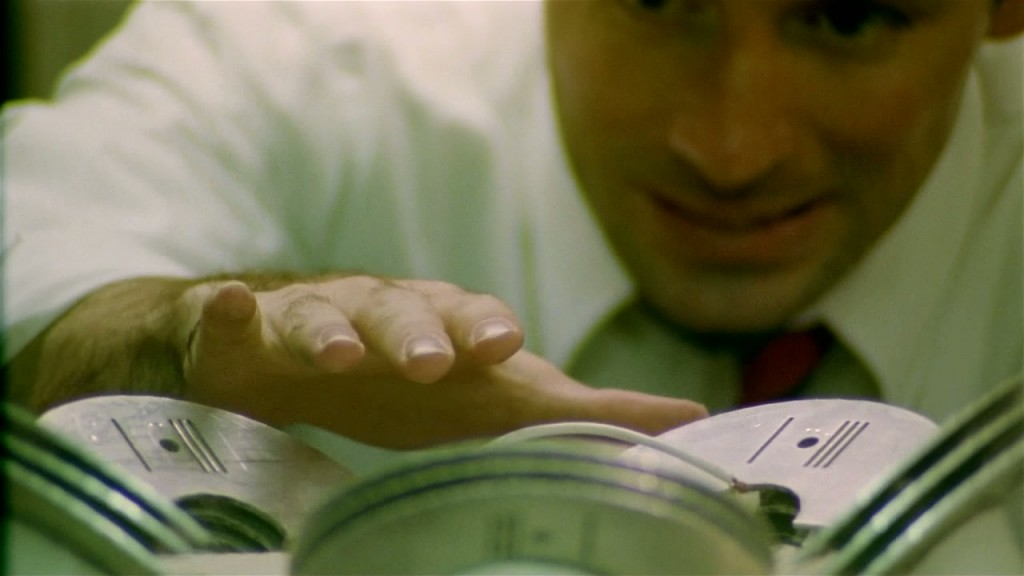 Aaron (Shane Carruth) tests the static of the machine.