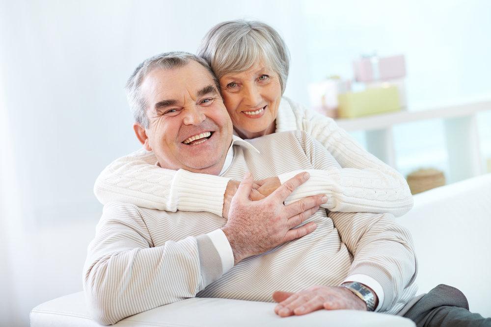 senior couple hugging at home.jpg
