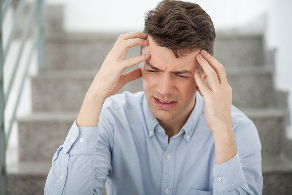 stressed adult stairway employee.jpg