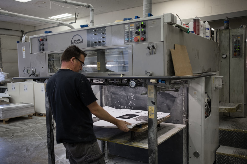 Taking a sheet of the press