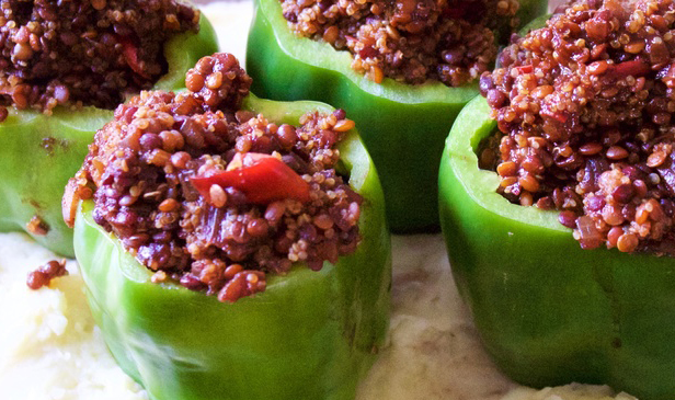 BBQ Lentil Stuffed Bell Peppers - Want to convince your non-vegan friends that vegan food is just as good as non-vegan food? Make this recipe! Sweet and tangy barbecue lentils, mixed with onions, and quinoa, stuffed inside green bell peppers and baked with mashed potatoes. Always a crowd pleaser!