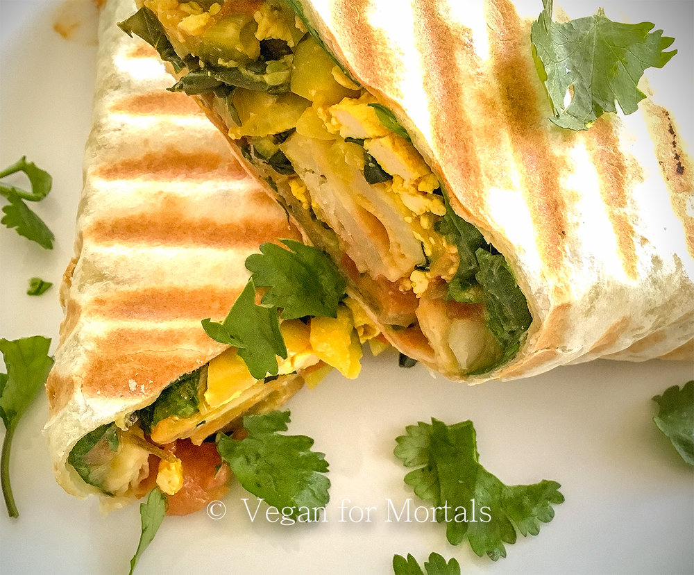 The Best Vegan Breakfast Burrito - Welcome to my favorite breakfast! These burritos are quick to put together with minimal prep work and they're always delicious! Let's be honest here and just use the massive flour tortillas, they hold the filling together better than any whole wheat or gluten free wrap I've tried.