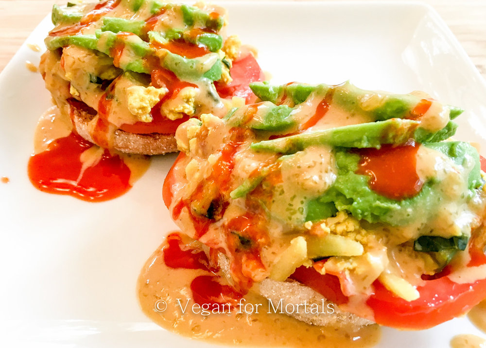 Vegan Tofu Benedict - Breakfast just got better. This may be my favorite breakfast - veggie filled tofu, spicy hot sauce, a crispy English Muffin, and a savory sauce - and it's SO EASY to make!