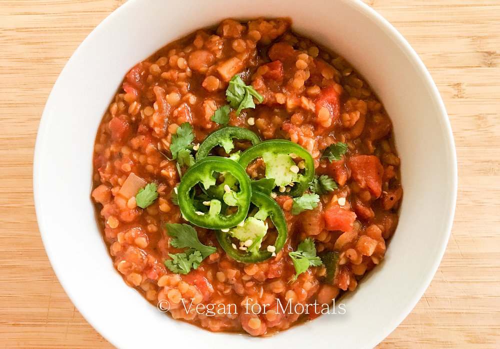 Red Lentil & Pinto Bean Chili - Red lentils and pinto beans make this chili super hearty and delicious. Toss in some zucchini and red bell pepper and you've got a medley of deliciousness just waiting to be eaten!