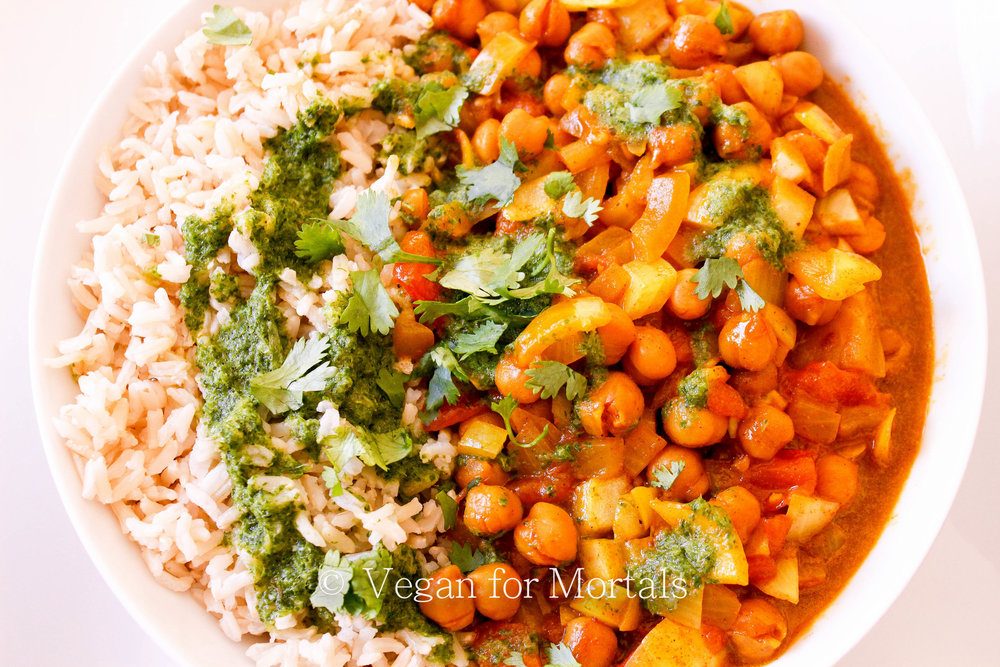 Chana Masala with Green Chutney - This is a super easy recipe you can put together on a weeknight for dinner. The spices blend together with the chickpeas making it a super filling and delicious meal, and the green chutney adds a little sweet and a little sour to balance out all the flavors!