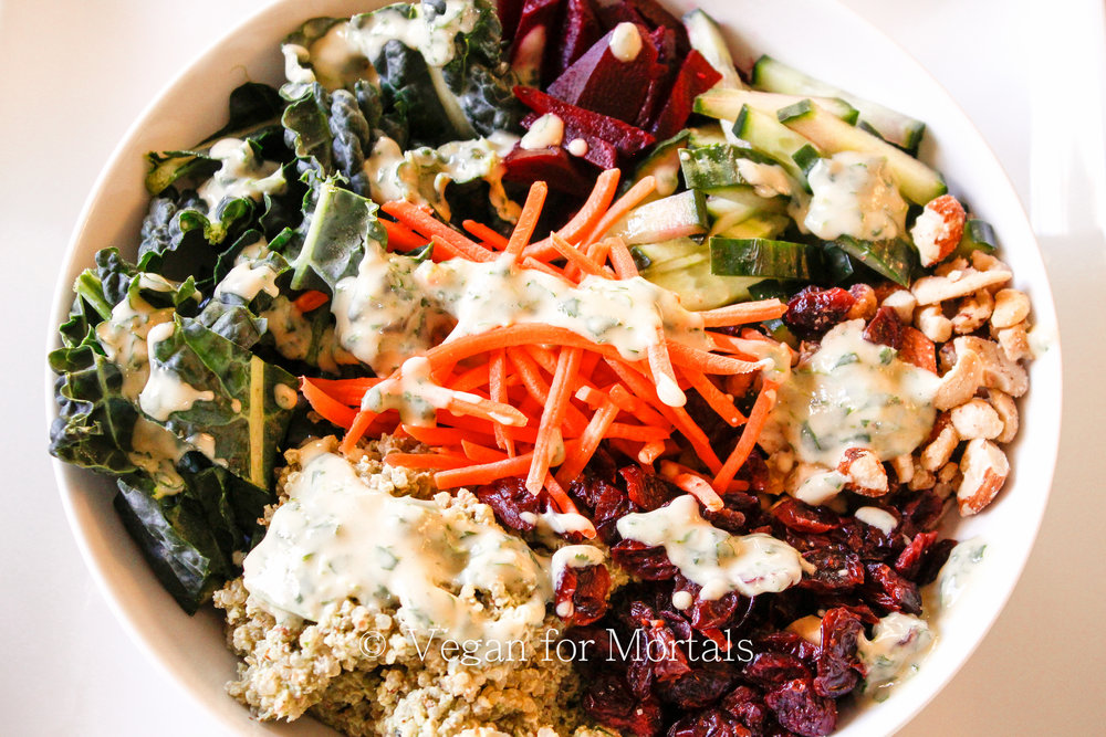 Kale Quinoa Bowl with Lemon Cilantro Hummus - This bowl is great boost your immune system during the winter! Loaded with kale, beets, mixed nuts, quinoa and a super tasty lemon hummus cilantro sauce - it's super quick to throw together if you make the quinoa ahead of time and use pre-cooked beets.