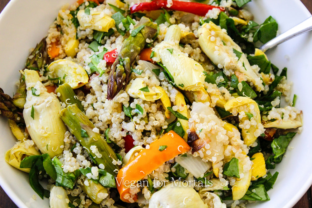 Spring Vegetable Couscous Bowl - This bowl is just as good hot as it is cold, which makes it PERFECT for leftovers! Its great as a full meal or a side dish and perfect for pot luck dinners! Its simple and easy to make with lots of vitamins and protein!
