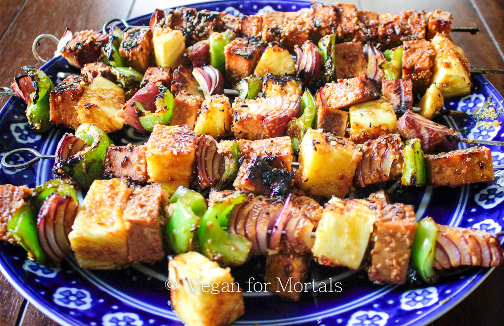 Teriyaki Tofu Kebabs - Grilling season is around the corner! These teriyaki tofu kebabs are super simple to put together and only require about 3 hours of marinating: read - 3 hours of your time spent doing other things! Pop them on a skewer with some veggies and your backyard BBQ will be in business!