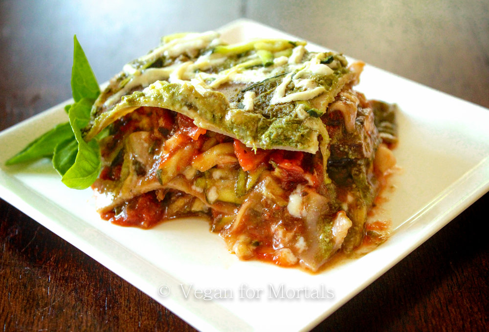 Pesto Lasagne - This lasagne uses both pesto sauce and marinara and is full of mushrooms, spinach, and shredded zucchini. A delicious twist on classic lasagne and super easy to make!