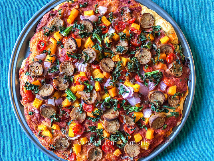 Butternut Squash & Kale Pizza - Topped with roasted butternut squash and red onion, savory sage and kale, sweet cherry tomatoes, and a leftover Field Roast Italian Veggie Sausage from a cookout makes this pizza a deliciousness explosion!