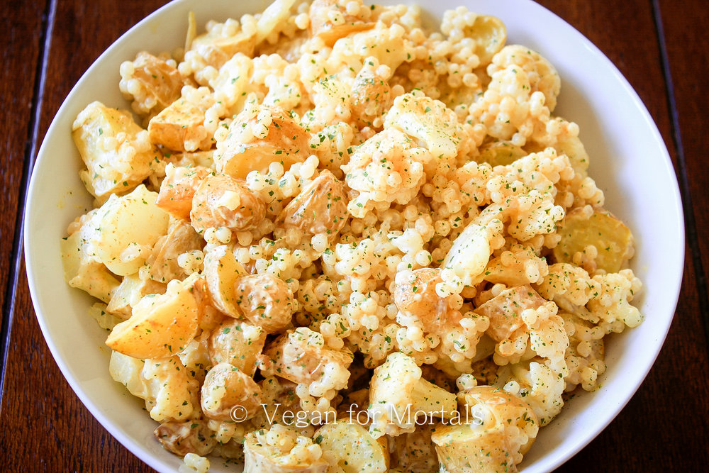 Curried Cauliflower, Potato, & Couscous Salad - Great ready for some SERIOUS deliciousness. If you're looking to mix up your potato salad recipe, give this a try. Roasted potatoes, steamed cauliflower, soft couscous, and curry powder! A few more ingredients and you've got a delicious new salad to enjoy!