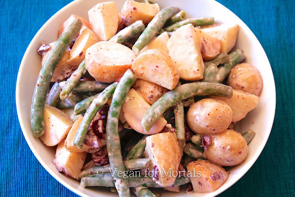 French Potato Salad - I love this potato salad! Its a twist on the classic version, but with the addition of blanched green beans, kalamata olives, red wine vinegar, and a few other simple ingredients. Great for a summer party or an evening at home!