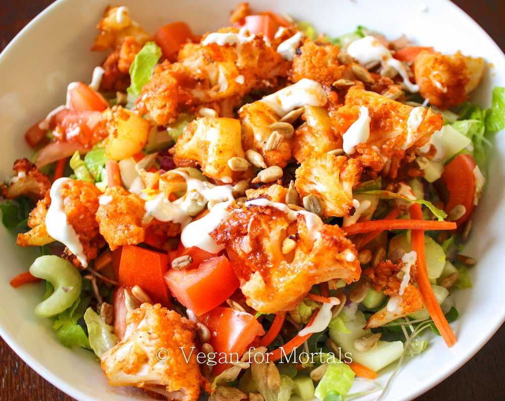 Buffalo Cauliflower Salad - I love Buffalo Style salads. Super spicy sauce, crunchy veggies, and creamy dressing. I feel pretty triumphant about making my own plant based version that I think is even more delicious than the original version. Give it a go and shave off a ton of calories in the process!