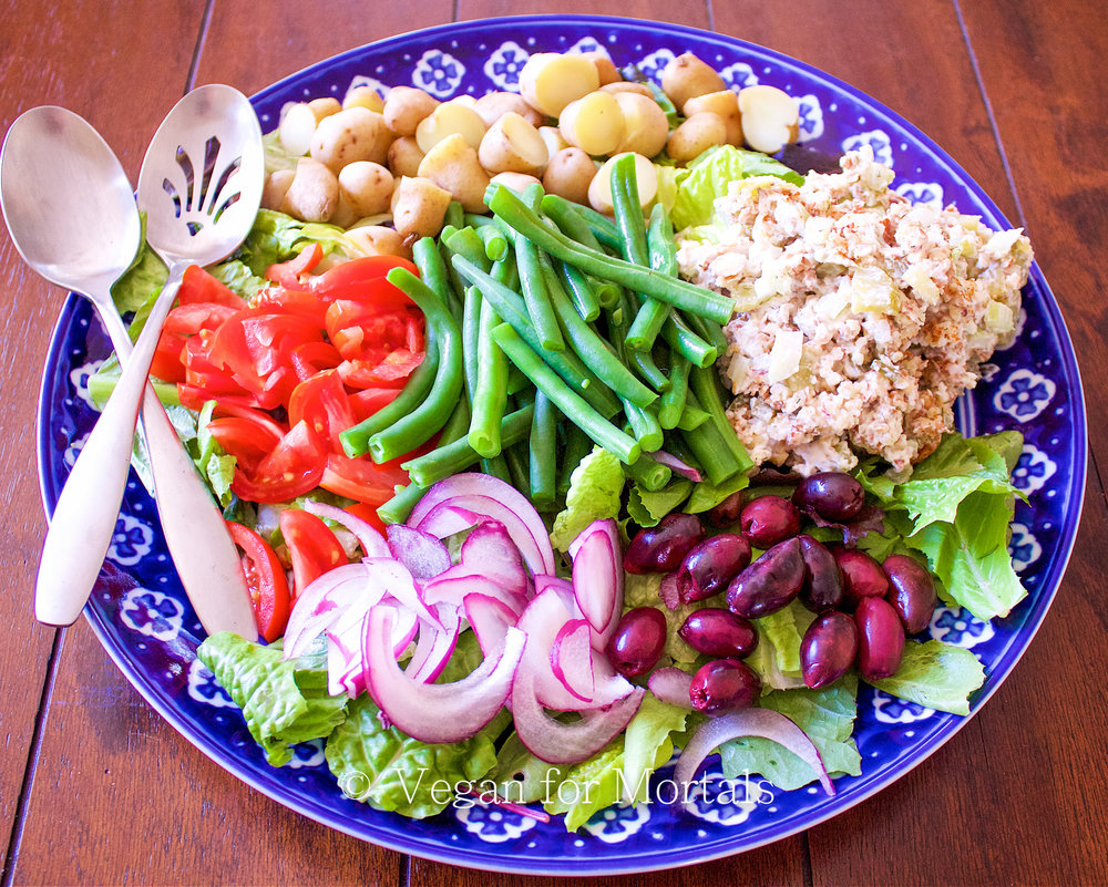 Vegan Nicoise Salad - Here's a twist on a traditional Nicoise Salad using Almond Salad in place of tuna and a honey dijon vinaigrette. Its great for a crowd or someone like me that could eat most of it in one sitting!