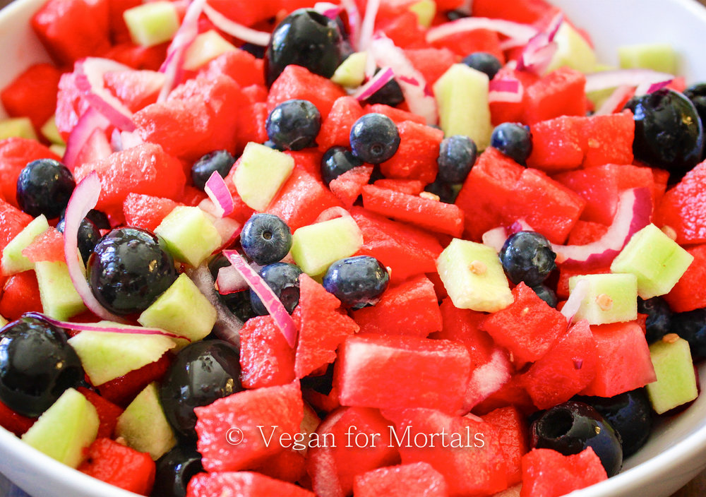 Watermelon Salad - Let me ask you a couple of questions. Do you like watermelon? Limes? Cucumber? Blueberries? Red Onions? Black Olives? Yes to all? Then make this salad! TRUST ME. These flavors combined are AMAZING!