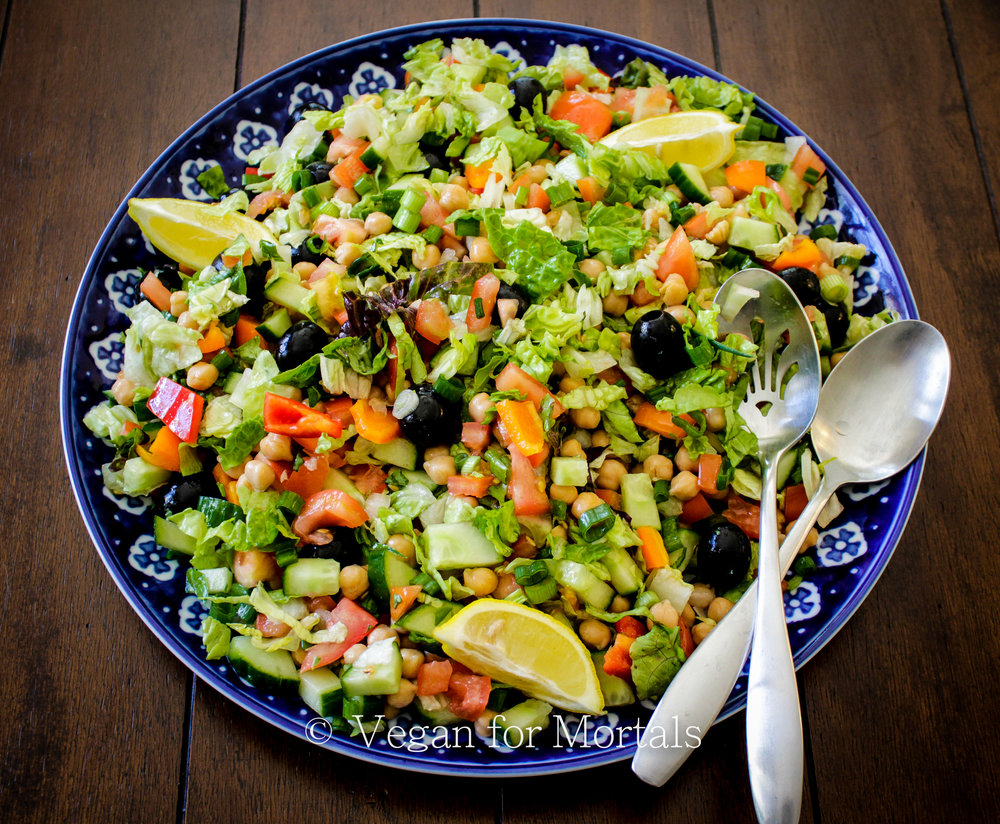 Italian Style Chopped Salad - Get chopping! This salad is super quick to throw together and delicious with a little splash of red wine vinegar and lemon juice or any kind of vinegar based dressing you like! Light and refreshing, yet filling and hearty!