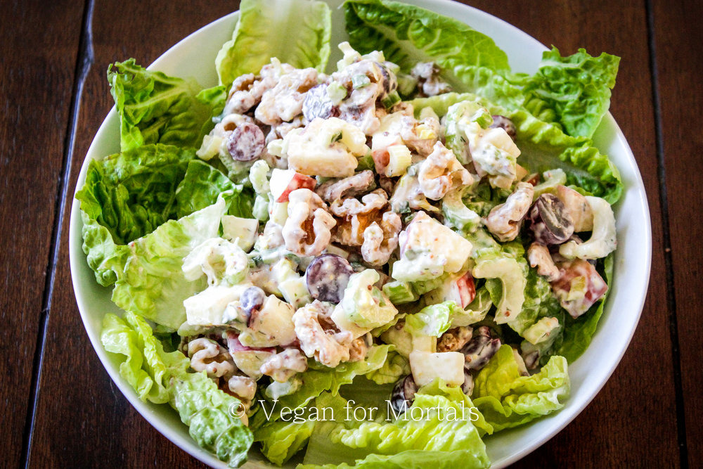Vegan Waldorf Salad - I love this salad! Its perfect for a hot day - cool and refreshing, crunchy and juicy, and includes all your favorites - apples, grapes, celery, and walnuts. You can serve it over lettuce or spinach to fill it out, or wrap it up in a tortilla for a delicious lunch!