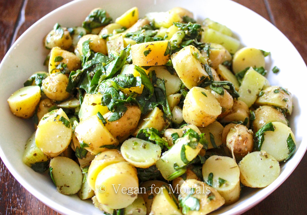 Greek Potato Salad - Here's a completely dairy free-substitute free potato salad that you will LOVE for hot summer days. Lemon juice, a dash of vinegar, chopped spinach, oregano, and parsley - its great for a picnic, a day at the beach, or a backyard BBQ!