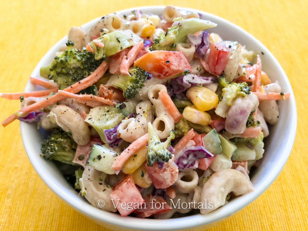 Summer Veg Pasta Salad - I LOVE SUMMER! And I love all the fresh produce summer brings. This pasta salad is full of tasty veggies and is a great addition to any summer BBQ that will please both vegans and non-vegans alike!