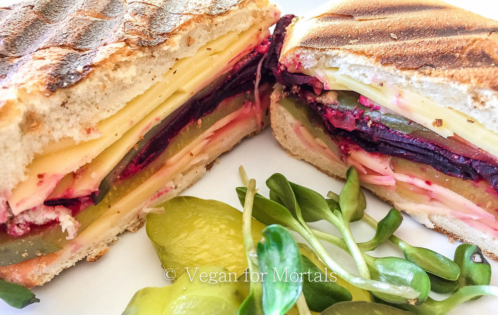 Beet Cuban Sammy - I used to love Cuban sandwiches. A grilled cheese with yumminess AND a pickle? Thankfully, because of the good people at Follow Your Heart I can make a similar plant based vegan friendly version with beets! Its insanely good and super easy to make!