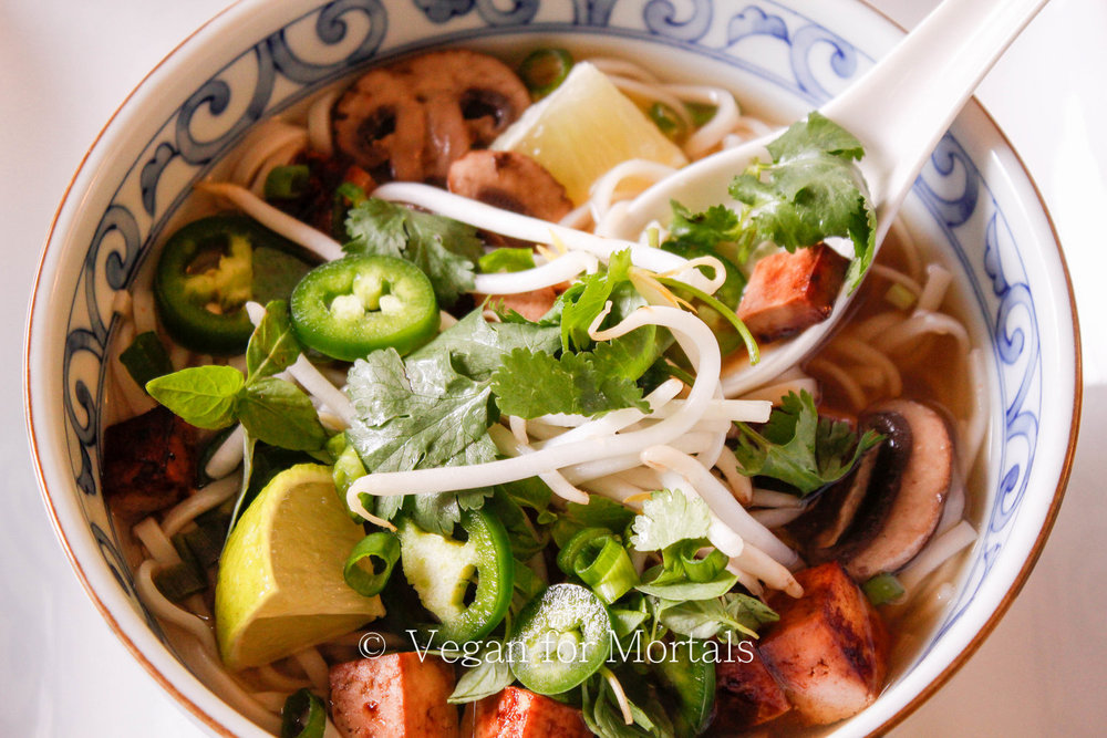Vegan Pho - Pho is SO EASY to make! There are three key spices to really get that familiar and comforting flavor of pho and the rest is super simple to put together. Make this recipe and you'll have a steaming bowl of goodness in no time.