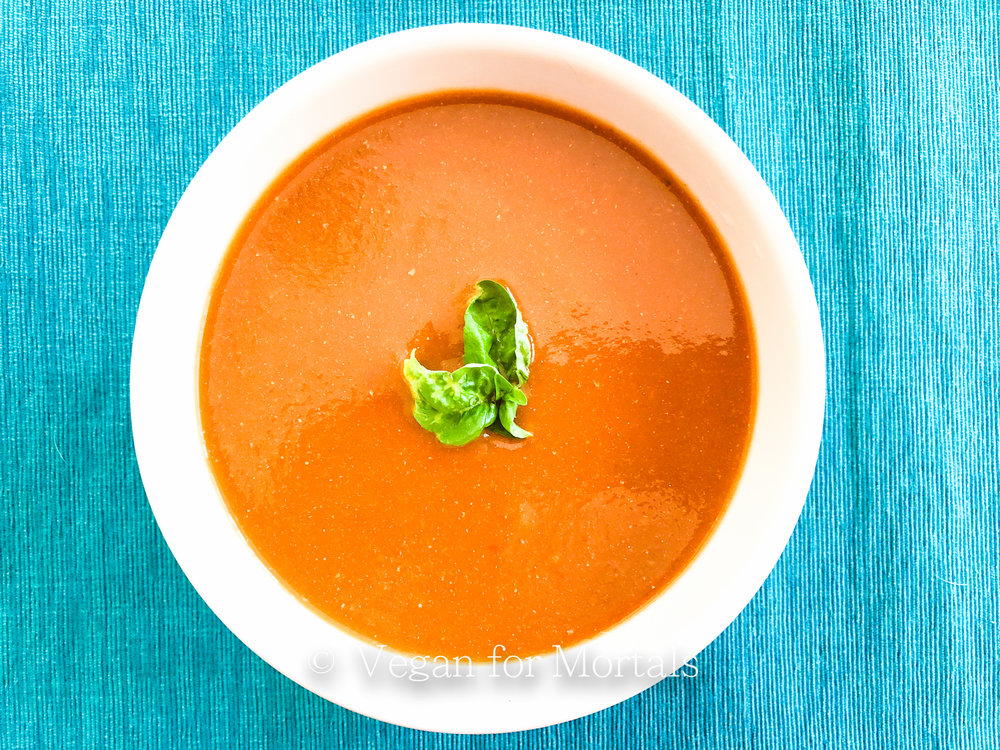 Tomato & Basil Soup - This soup is so much better than the canned version and crazy easy to make! There's a little chopping involved, a little blending, and that's basically it! Tomato & Basil soup in about 30 minutes!
