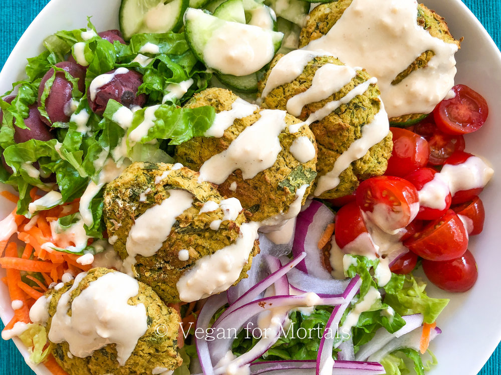 Falafel Salad - I looooooooooooove falafel. I'm kind of obsessed with it. I started eating it so much I figured I should figure out how to make it at home and once I did, I can't believe I waited so long! Its super simple to make, crazy delicious, and as much as I love the fried version, this baked recipe is much healthier.