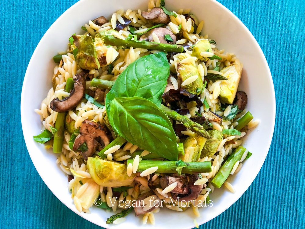 Spring Orzo Salad - This salad is incredibly versatile! Its delicious hot or cold, its delicious as is, or with some marinara mixed in and warmed through. Its delicious mixed with some chopped greens and an Italian style salad dressing poured over the top. You can add in kalamata or green olives, or toss in some crunchy croutons. This salad is just a base of many delicious meals you have during the week!