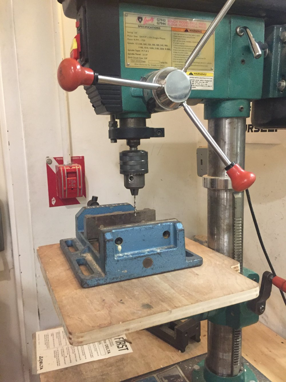 Drill press and mighty clamp.