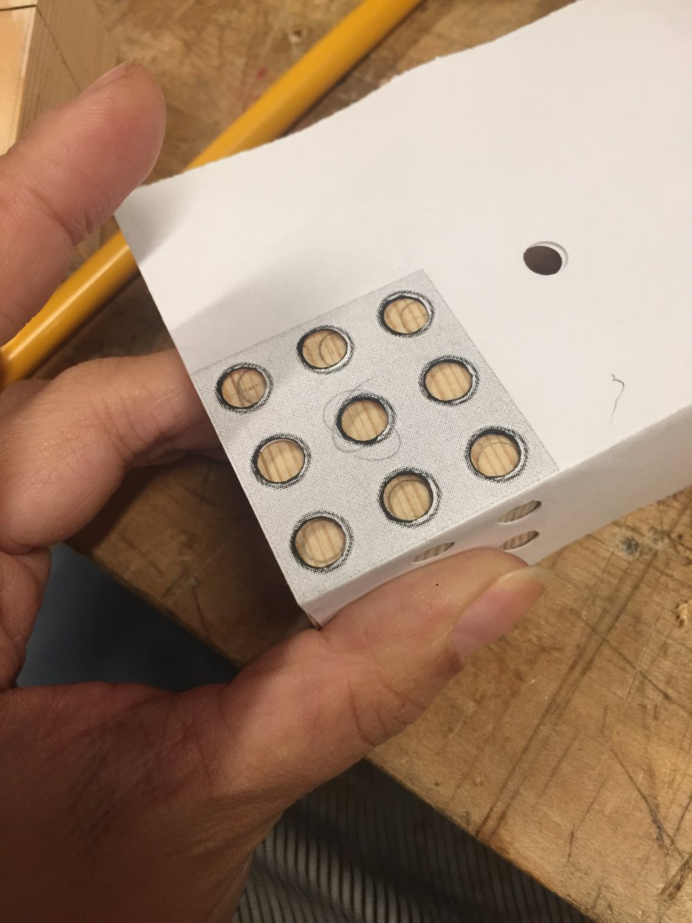 """Dot stencil """"jig"""" placed over each cube."""