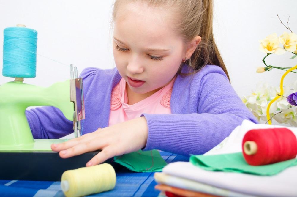 girl sewing-smaller.jpg