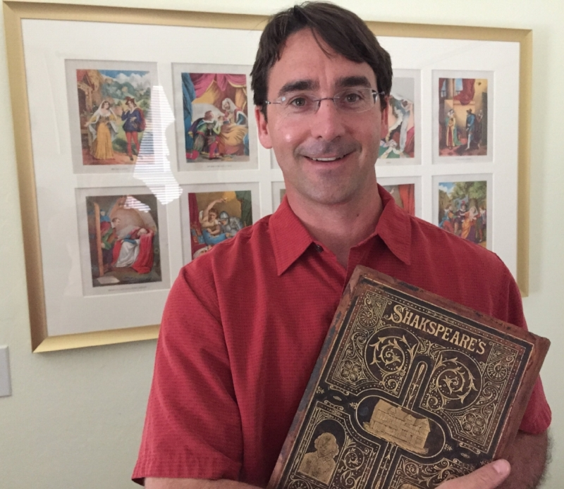 SHAKESPRINTS FOUNDER, CRISPIN CLARKE, WITH THE 1876 DELUXE COMPLETE WORKS OF WILLIAM SHAKESPEARE THAT HE INHERITED FROM HIS GRANDFATHER.